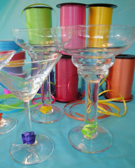 cocktail glasses and spools of curling ribbon