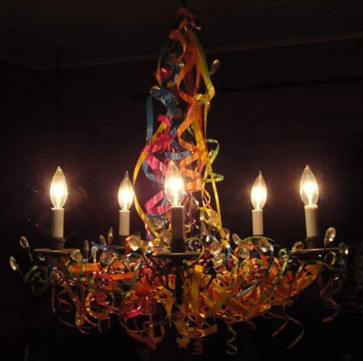 a chandelier decorated with curling ribbon