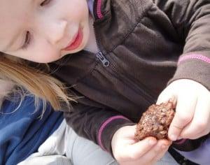 a girl holding a yum-yum bar