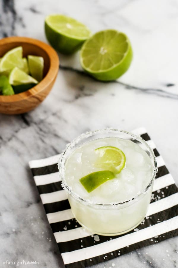 Traditional Margaritas recipe from afarmgirlsdabbles.com - This cocktail recipe offers the perfect thirst-quenching drink for any Mexican meal. Made with fresh-squeezed lime, it's authentic in every way.