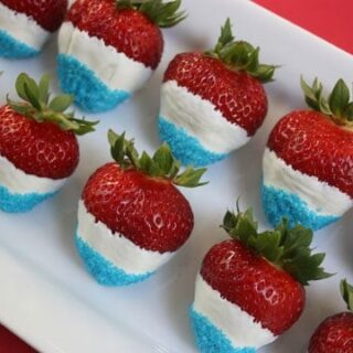 strawberries dipped in white chocolate with blue sprinkles