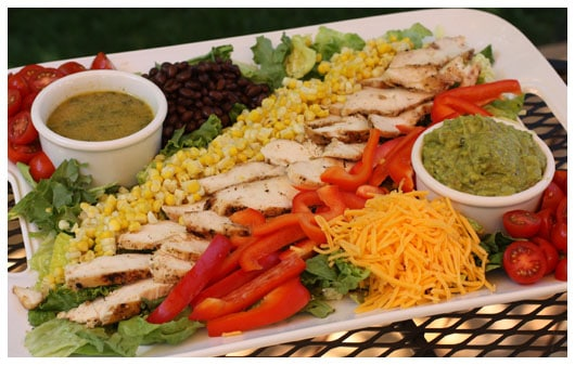 a large tray of chicken salad ingredients