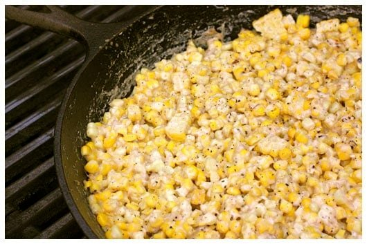 a skillet of creamed corn on the grill