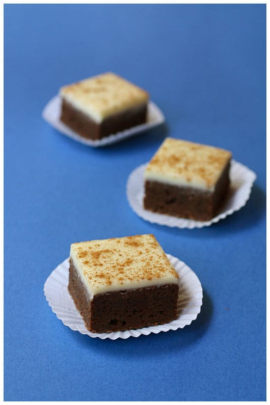 three brownie squares with a white frosting