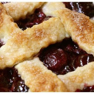 a close up view of cherry pie with a lattice crust