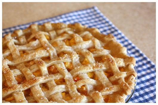 a peach pie with lattice crust