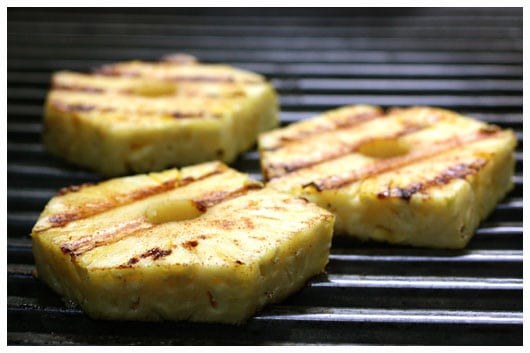 pieces of pineapple on the grill