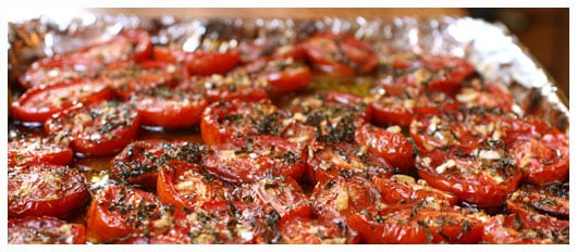 Oven roasted tomatoes on a foil lined baking sheet