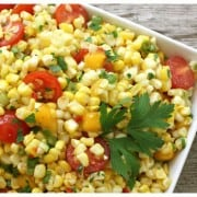 a white dish of corn and tomato salsa
