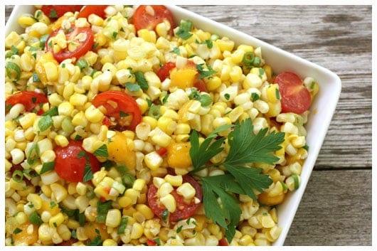 a white dish of corn and tomato salsa