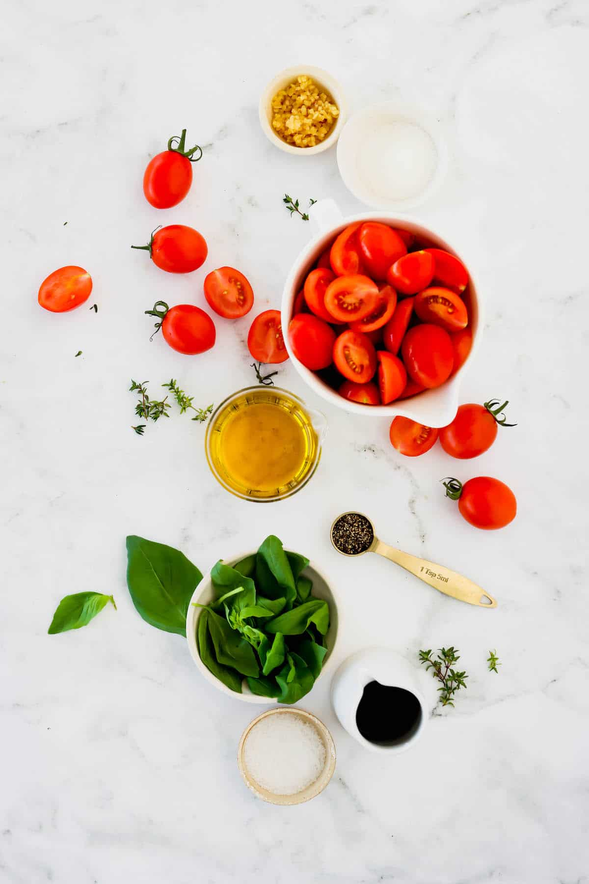 Overhead view of the ingredients to make roasted tomatoes
