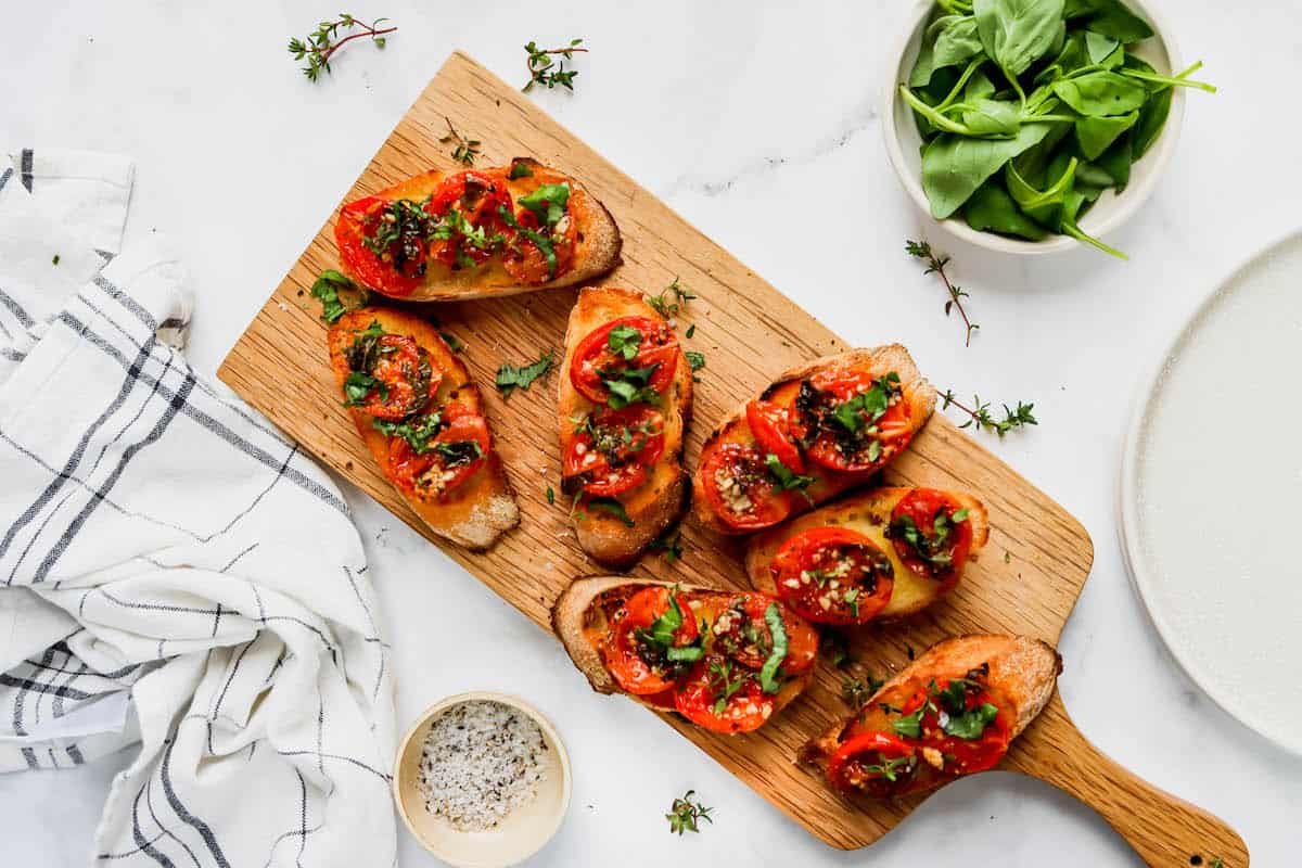 Oven roasted tomatoes on slices of a baguette