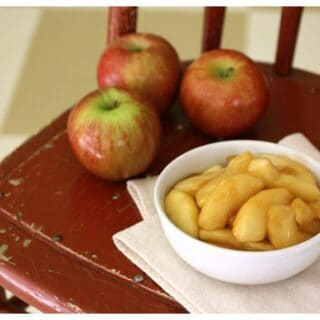a white bowl of sautéed apples