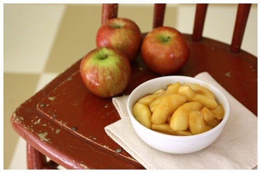 a white bowl of sautéed apples