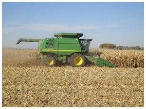 John Deere combine in corn field