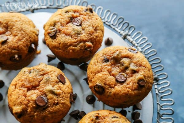 Pumpkin Chocolate Chip Muffins from afarmgirlsdabbles.com - These pumpkin muffins with chocolate chips are warmly spiced and super moist. They're a delicious baked treat for fall and winter. I always get asked for the recipe! #pumpkin #chocolate #chocolatechip #muffins #muffin #fall