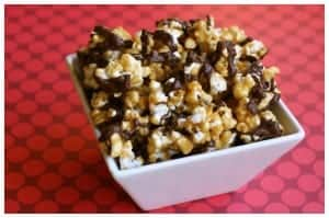 caramel corn with chocolate drizzle in a white dish