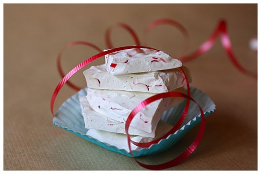 Peppermint Bark from afarmgirlsdabbles.com - Homemade Peppermint Bark is festive for the holidays, and this recipe's snow-white color is especially pretty. We make this easy recipe every single year! #peppermint #bark #christmas #holiday #nobake