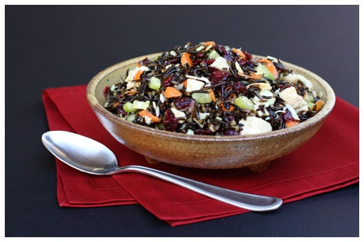 a pottery bowl of turkey and wild rice salad