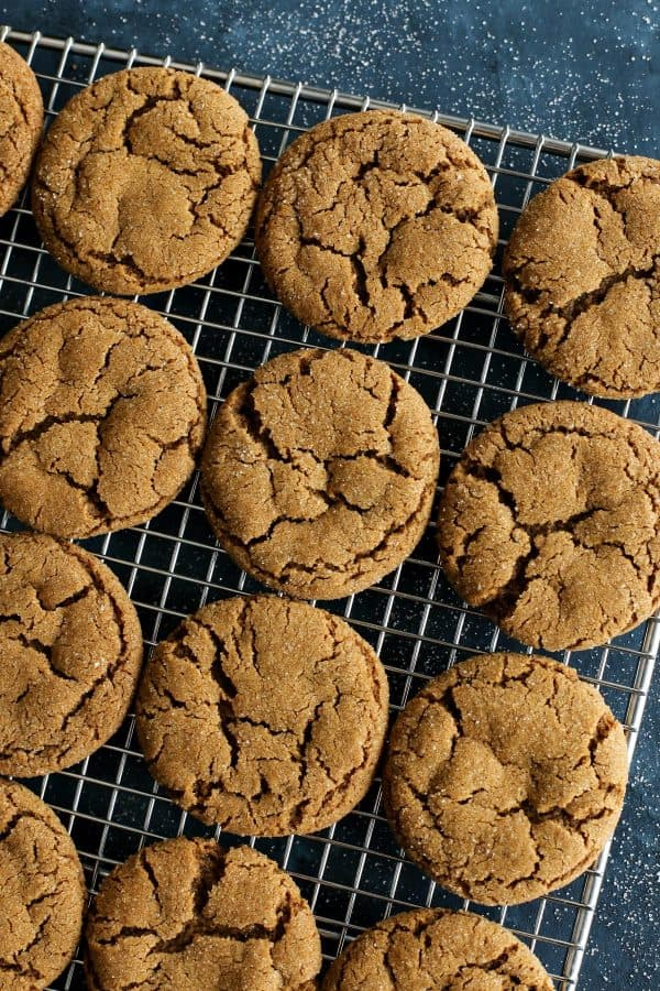 Chewy Ginger Molasses Cookies from afarmgirlsdabbles.com - The ultimate fall and holiday cookie. These molasses cookies are perfectly soft and chewy, with just the right amount of spices and molasses. And they're easy to make, with no need to chill the dough! #cookies #molasses #ginger #soft #chewy #christmas #spiced