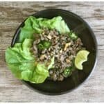 a pottery bowl of lettuce and ground pork