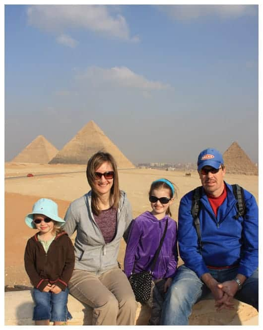 a family photo in front of the pyramids in egypt