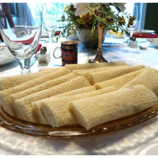 A glass plate of lefse pastries on a table