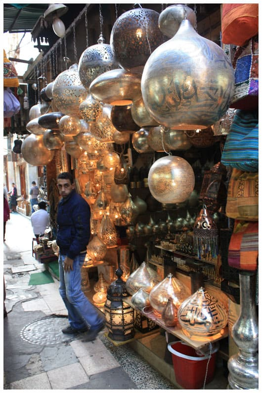 a stand selling metal lamps