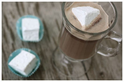a cup of hot chocolate with a marshmallow in it