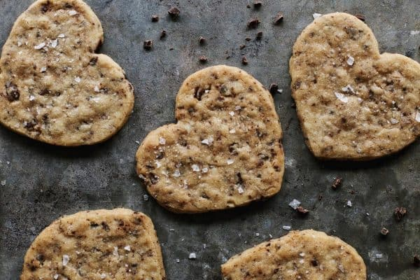 shortbread cookies speckled with chocolate, in the shape of hearts