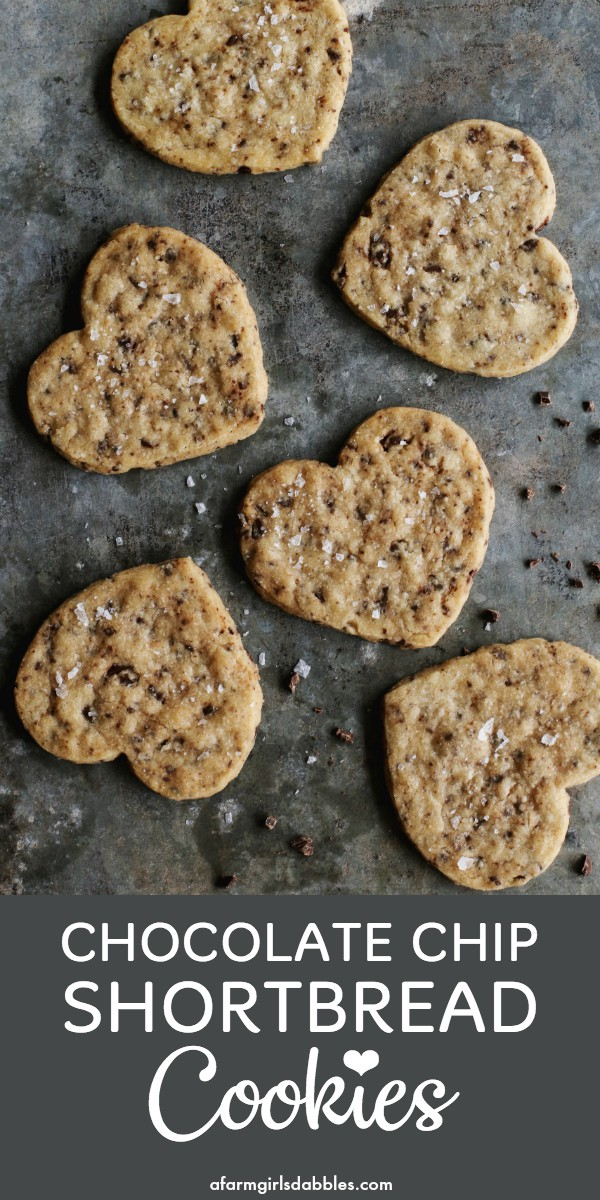pinterest image of a pan of heart-shaped Chocolate Chip Shortbread Cookies