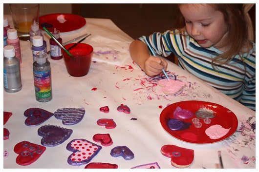 a girl painting ornaments