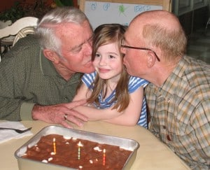 a girl and her two grandpas