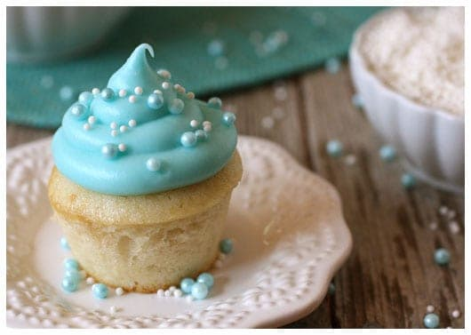 a mini cupcake with blue frosting