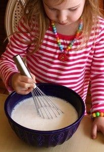 a girl Whisking Lemon Buttermilk Sherbet