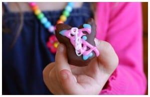 a girl holding a chocolate marshmallow bunny