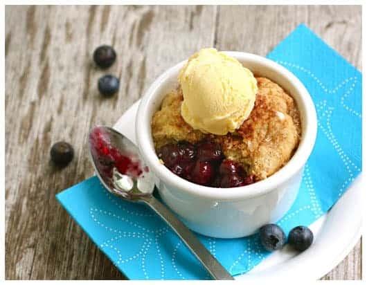 an individual blueberry pot pie with vanilla ice cream