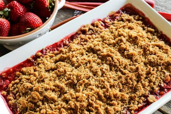 strawberry rhubarb crisp in a large white dish