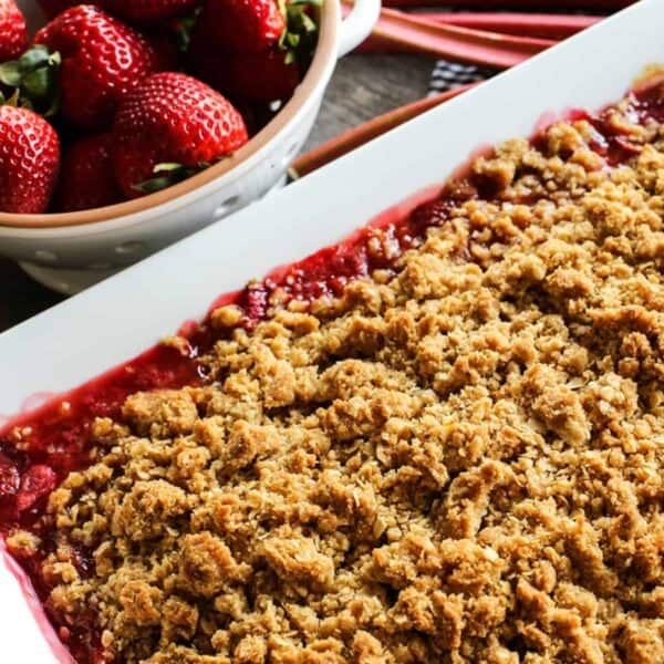 a pan of dessert crisp made with strawberries and rhubarb