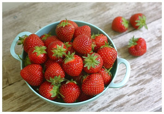 a colander of strawberries