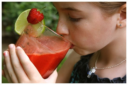 a girl drinking from a glass
