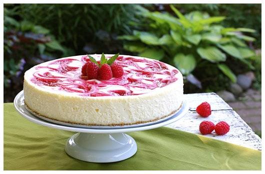 a whole raspberry swirl cheesecake