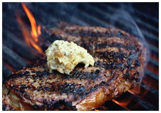 a steak on a grill with butter