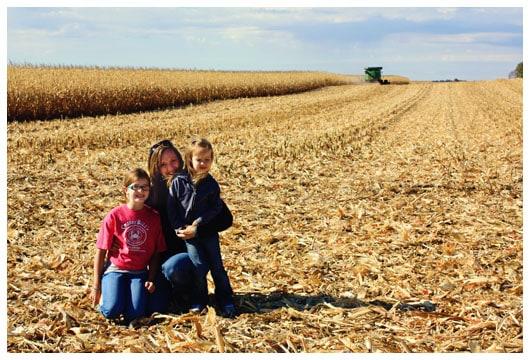 three girls in a corn field