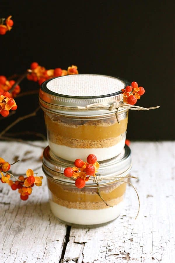 Layered Pumpkin Pie in a Jar from afarmgirlsdabbles.com - This layered pumpkin dessert is my favorite way to enjoy the flavors of traditional pumpkin pie. The dessert is creamy and beautifully spiced and oh-so-fun and pretty in jars! #pumpkin #pie #layered #thanksgiving #dessert #jar