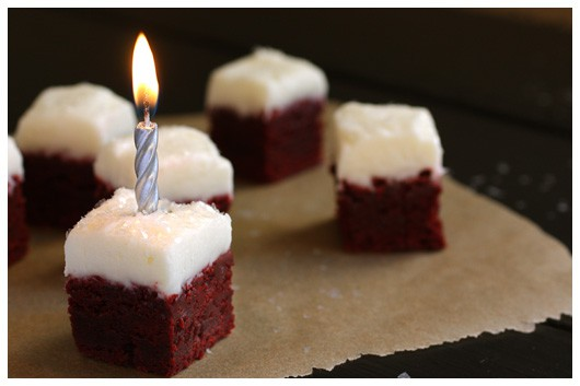 a brownie bite with a lit candle on top