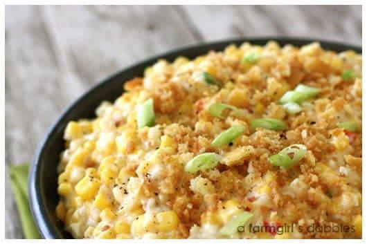 Cheesy scalloped corn in a black bowl