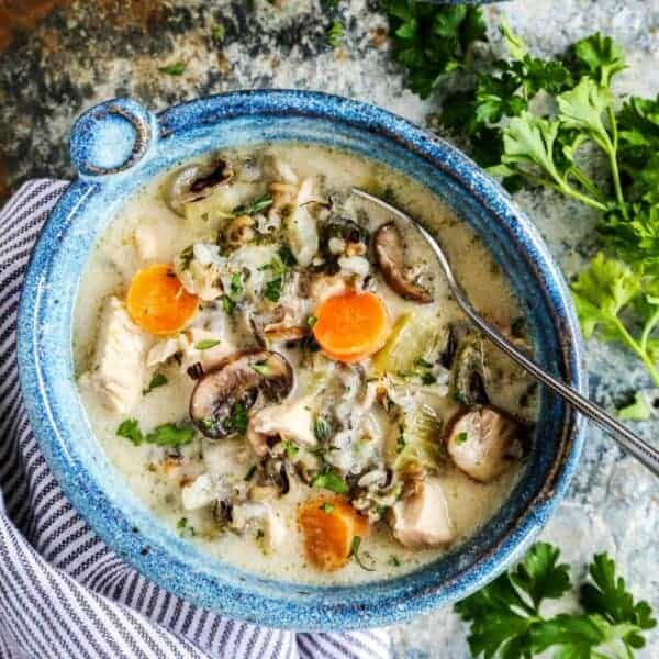 Chicken Wild Rice Soup from afarmgirlsdabbles.com - This hearty Chicken Wild Rice Soup is pure comfort on a chilly day. It's lightly creamy, very flavorful, and loaded with chicken, wild rice, and vegetables. We also like to make this with turkey, especially smoked turkey from Thanksgiving leftovers. #soup #wildrice #rice #creamy #chicken #turkey