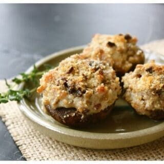 a plate of cheesy stuffed mushrooms