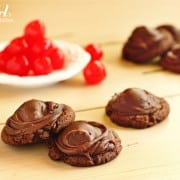 a pile of chocolate cherry cookies